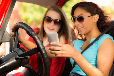 Women texting and driving